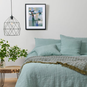 Washed Bed Linen in Blue Greenish Color. Linen Bedding: duvet cover, pillowcase, bed sheet. Produced in Europe.