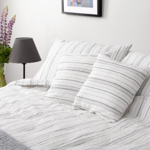 White linen bedding in grey stripes. Produced by AB 'Siūlas'