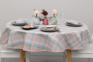 Round linen tablecloth in pink, bluish, greenish, light gray checks. Produced in Lithuania