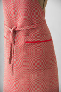 "Red linen apron in checks pattern, with pockets. Manufacturer: AB ""Siulas"""