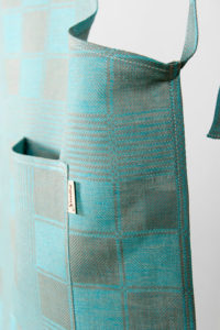 "Linen apron in checked pattern, grey and light blue checks. Manufacturer: AB ""Siulas"""
